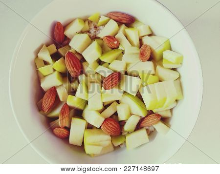 Mixture Of Almonds Oatmeal And Apple In A Large Bowl