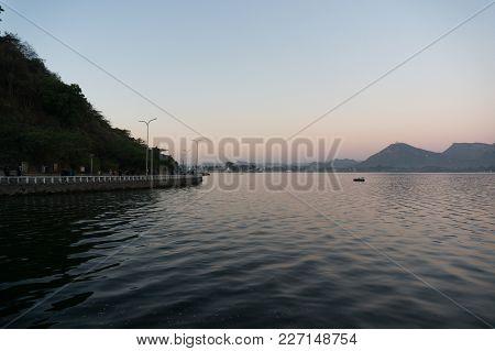Serene Dawn Shot Of Fateh Sagar Lake Udiapur India. This Famous Tourist Destination Of India Invites