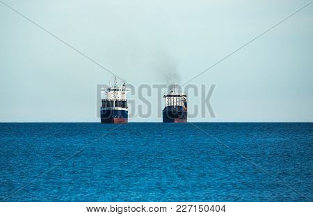 cargo ship skyline sailing in still water Transport and logistics, export, merchandise transports poster