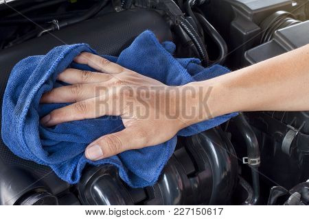 Man Check Clean And Maintenance The Engine Of Car.