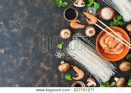 Background With Ingredients Of Asian Food For Cooking On A Rustic Dark Background. Top View, Copy Sp