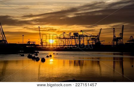 Harbor Sunrises Red Colors In The Sky And Water Reflection Many Load Cargo Cranes Port Skyline Ready
