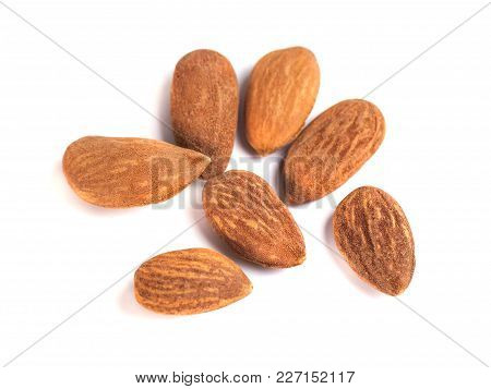 Heap Of Brown Roast Almonds On White Background
