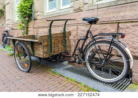 Amsterdam, The Netherlands - 13 August 2017: Wooden Handcart Built On Bicycle Frame For Transporting