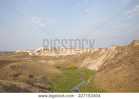 Landscape With Beautiful View Of Valley And Limestone Quarry.