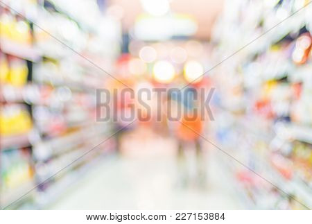 Blur Background Of Customer Shopping With Shopping Cart At Supermarket Store Product Shelf With Boke