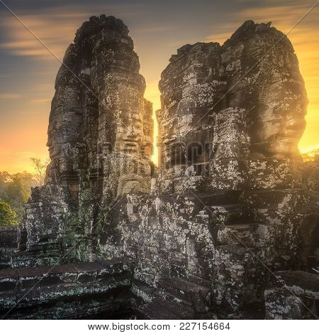 Sunrise View Of Ancient Temple Bayon Angkor Complex With Stone Faces Of Buddha Siem Reap On Sunset,