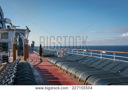 A Women Is Awake Early To Do A Moring Walk On-board This Cruise Ship.