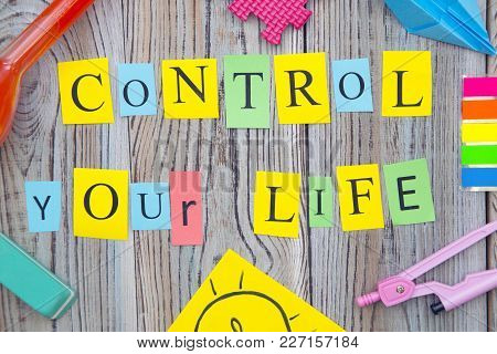 Education Concept. Control Your Life Inscription And School Supplies On A Wooden Background, Top Vie