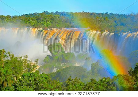 Fantastic View Of Iguazu Falls At Sunset Time. Argentina And Brazil.