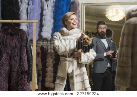 Sensual Woman In Fur Coat With Man, Shopping, Seller And Customer. Sensual Woman With Yorkshire Terr