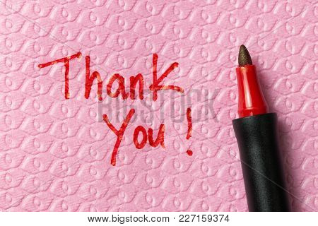 Thank You Word Written On Napkin With Red Pen