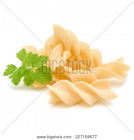 Italian  twisted pasta fusilli isolated on white background. Fusilloni, rotini.