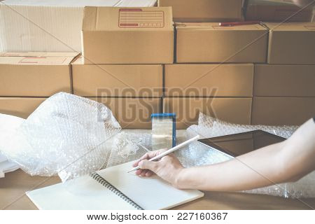 Startup Small Business Owner Working At Workplace. Freelance Woman Seller Check Product Order For De