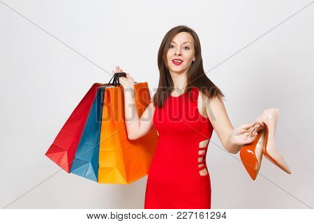 Attractive Impressive Glamour Caucasian Fashionable Young Brown-hair Woman In Red Dress Holding Beig