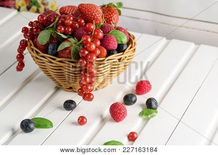 Summer Fruit, Raspberry, Blueberry, And Strawberry In Basket