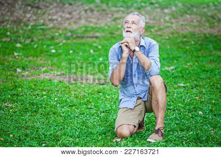 Portrait Of An Elderly, Senior Sad Man With White Hair, Looking Upwards And Praying And Asking For A