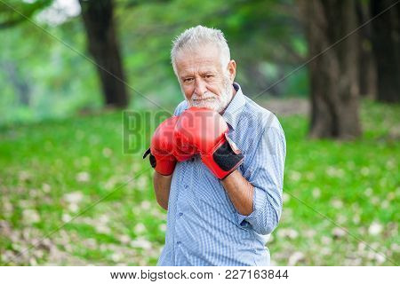 Happy Funny Senior Boxer Man With Red Gloves In Park