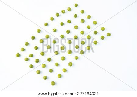 Flat Lay Of Arranged Green Peas On White Background