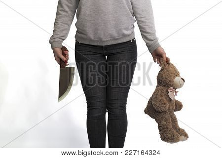 Girl Holding A Knife And A Toy