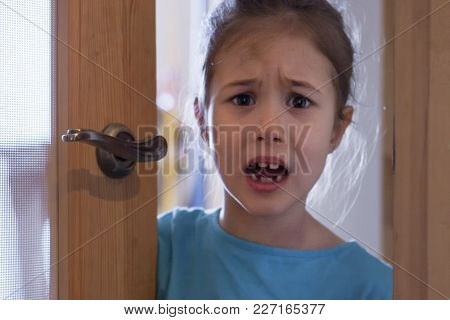 An Angry Child Closes The Door Of His Room From His Parents