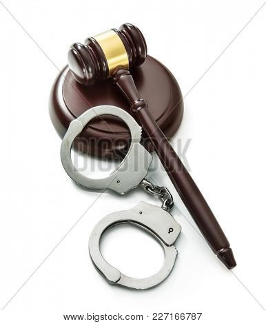 Handcuffs and Judge Gavel isolated on white background