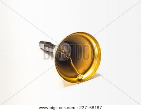 Gilded Bell With A Handle Made Of Black Plastic Isolated On A White Background