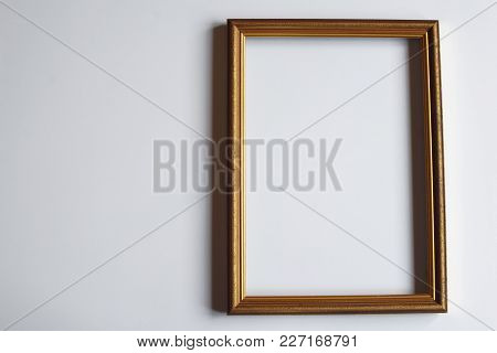 Brown Golden Color Vertical Frame For Picture Or Photo On Light Background. Top View.