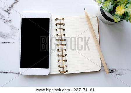 Smart Phone With Blank Screen On Blank Notebook Paper Background, Mock Up, Flat Lay