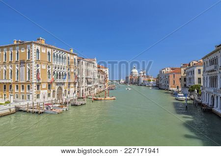 Venice,italy-july 17,2012: City View, Grand Canal, Canal Grande And Venetian Houses, Venice, Italy.