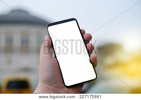 Hand Holding Mobile Smart Phone With Blank Screen.