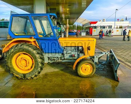 Prague, Czech Republic - January 2, 2018: The Colorful Tractor Is Parked Near The Gas Station At Pra