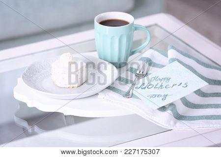 Tasty dessert, cup of coffee and card with words