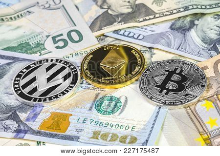 Bitcoin, Litecoin And Ethereum Coin On Dollar And Euro Bills. Cryptocurrency Background