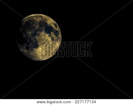High Contrast Full Moon Seen With An Astronomical Telescope, With Enhanced Colours To Show The Real
