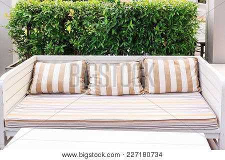 Chair In The Garden. Chair On A Wooden Walkway. Balcony In The Garden