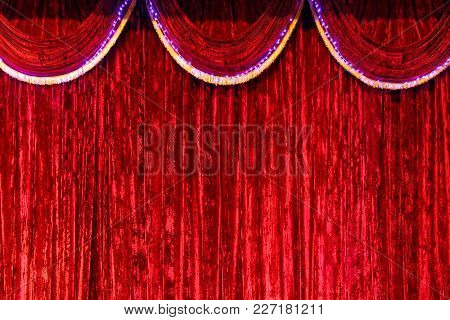 Bright, Red Curtain On Stage As Background.