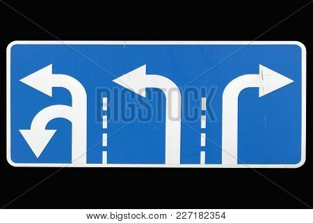 'direction To Be Followed' Road Sign Isolated On Black