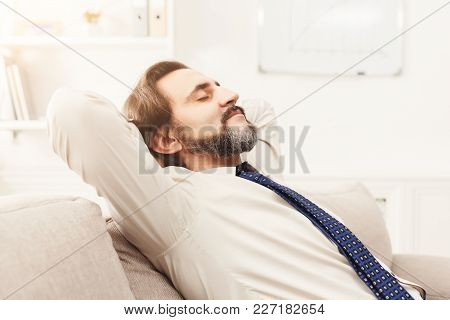 Successful Business Background. Relaxed Businessman Taking Rest In Modern Office, Copy Space