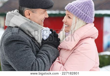 Portrait of happy mature couple outdoors on winter day