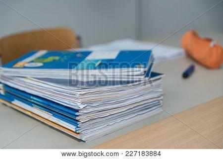 Exercise Books On Teacher's Desk