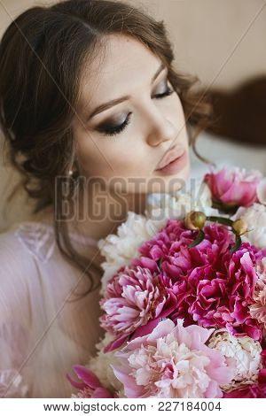 Portrait Of Beautiful Young Brunette Woman With Closed Eyes And Big Seductive Lips, With Bouquet Of