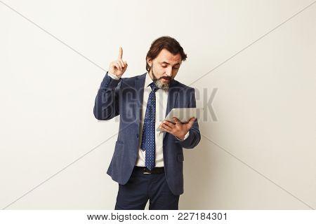 Bearded Man Using Tablet Computer, Found Something Interesting, Raising Hand Upwards, Success Concep