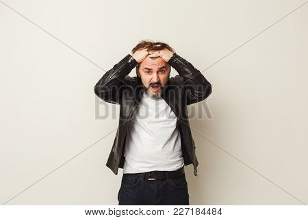 Portrait Of Desperate Man Holding His Head. Panic, Emotional Stress, Brain Explosion Concept