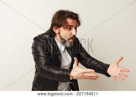 Portrait Of Angry Man, Screaming And Gesturing, White Studio Background. Panic, Emotional Stress, Br