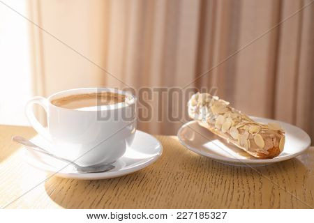 Cup of aromatic coffee and delicious dessert on table. Tasty breakfast