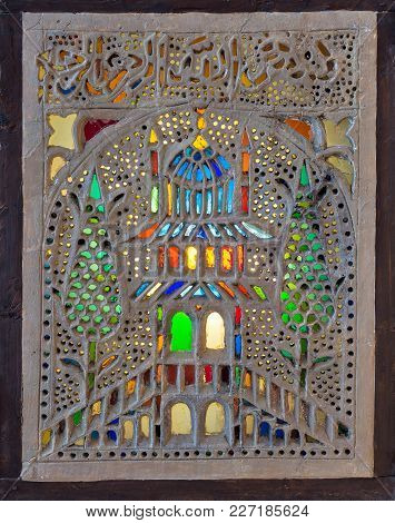 Perforated Stucco Window Decorated With Colorful Stain Glass With Floral Patterns, One Of The Tradit