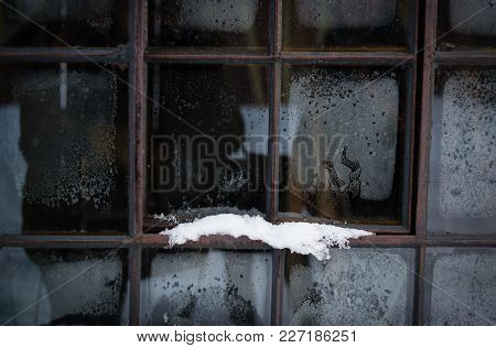 Old Window With Hoarfrost And Snow