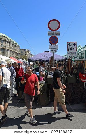 Vienna, Austria - July 11, 2015: People Shopping At Naschmarkt Flea Market Saturday In Vienna, Austr