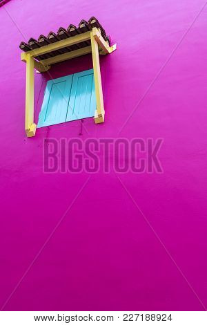 Closed Window Shutters In A Pink Wall